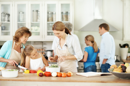 Multi-Generational family cooking in a kitchen together